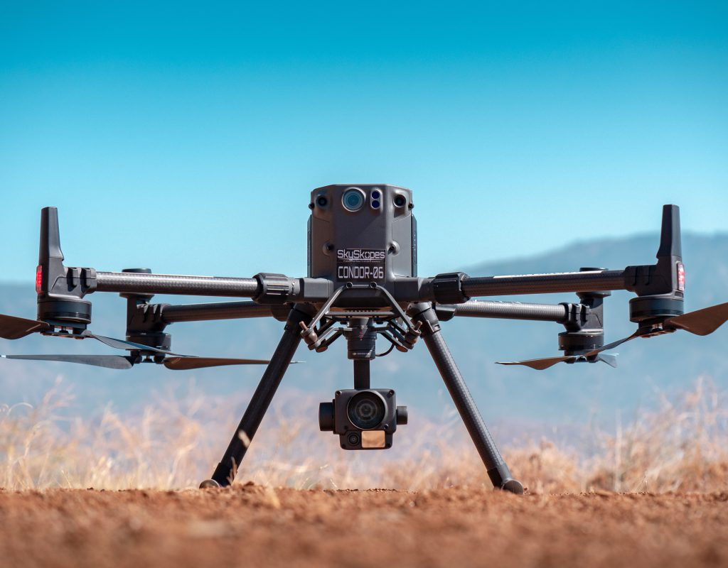 Drone in flight over land